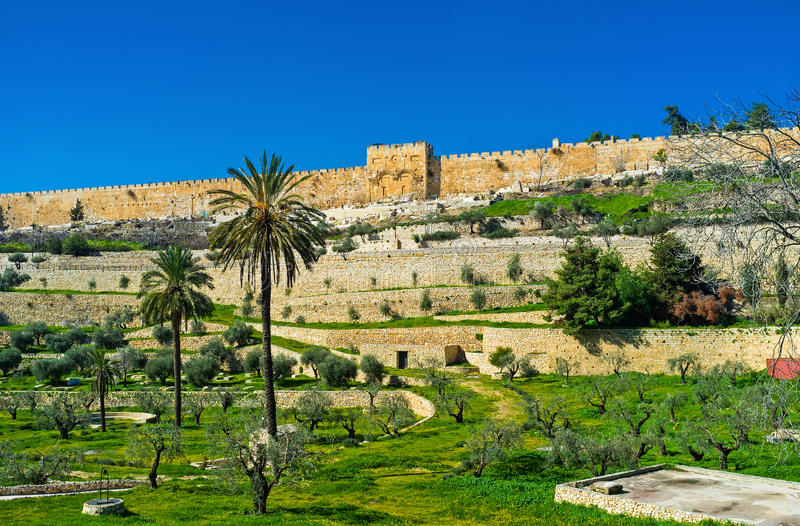 The rramparts of Jerusalem. The view on the high ramparts and walled Golden Gate with the Muslim Cemetery in front of it from the Kidron Valley, Jerusalem royalty free stock photography