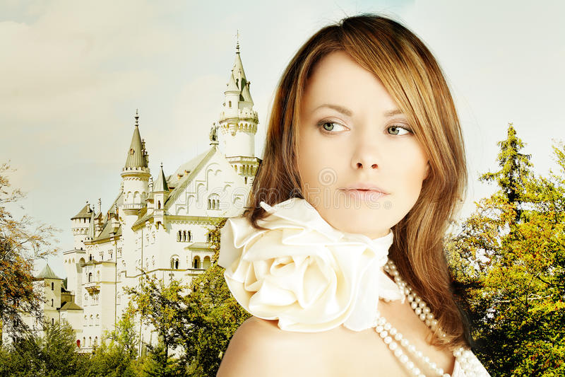 Rromantic escape, beautiful young woman and fairytale castle stock photos