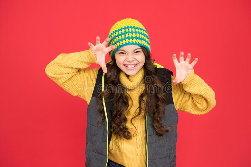 Rrrrr I will catch you. Crazy cutie red background. Crazy child roar with frightening gesture. Little girl with crazy. Look. Winter fashion and accessory for royalty free stock images