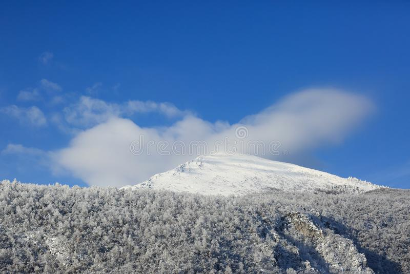 Rtanj Pyramid mountain - Snow on a Cloud Covered Mountain Peak royalty free stock images