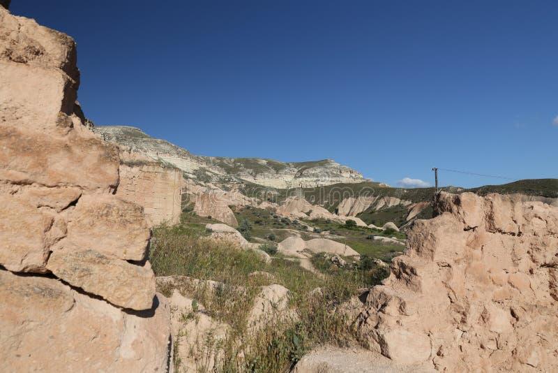 Ruínas na vila de Cavusin, Cappadocia fotografia de stock