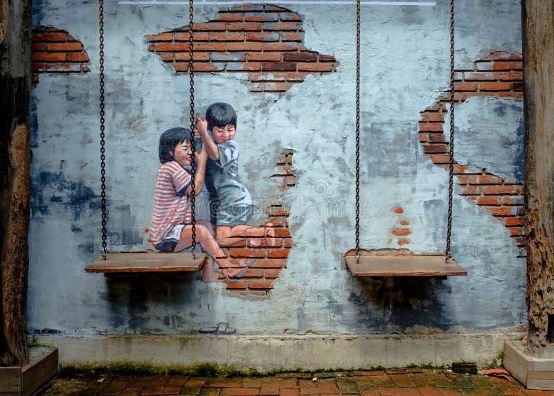 RUA ART Painting o no havi bonito das irmãs mais nova da parede dois imagem de stock royalty free