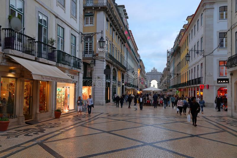Rua Augusta, Lisbon. LISBON, PORTUGAL - JUNE 5, 2018: People visit Rua Augusta shopping street in Lisbon. Lisbon is the 11th-most populous urban area in the EU ( royalty free stock photos