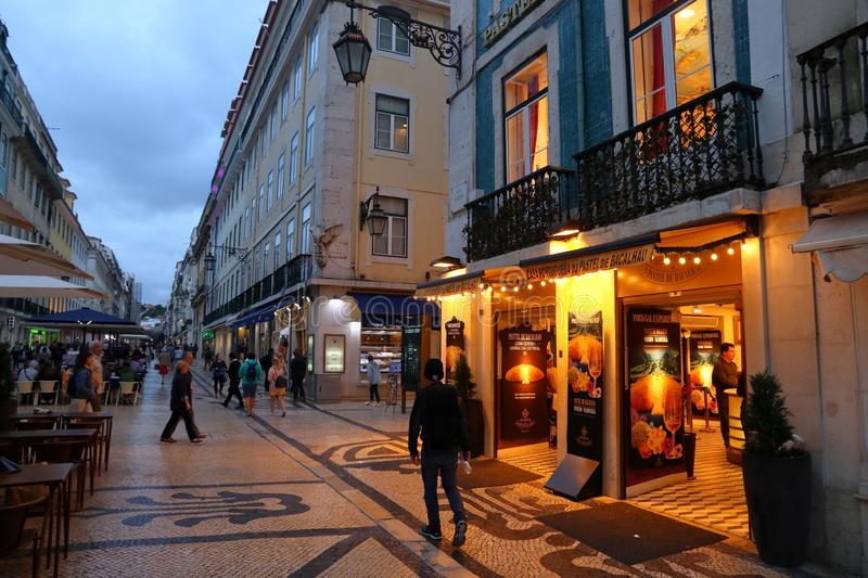 Rua Augusta, Lisbon. LISBON, PORTUGAL - JUNE 5, 2018: People visit Rua Augusta shopping street in Lisbon. Lisbon is the 11th-most populous urban area in the EU ( royalty free stock photo