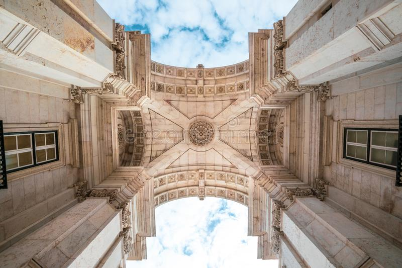 Rua Augusta triumphal Arch in the historic center of the city of Lisbon in Portugal. Blue sky with clouds. Perspective from the road stock images