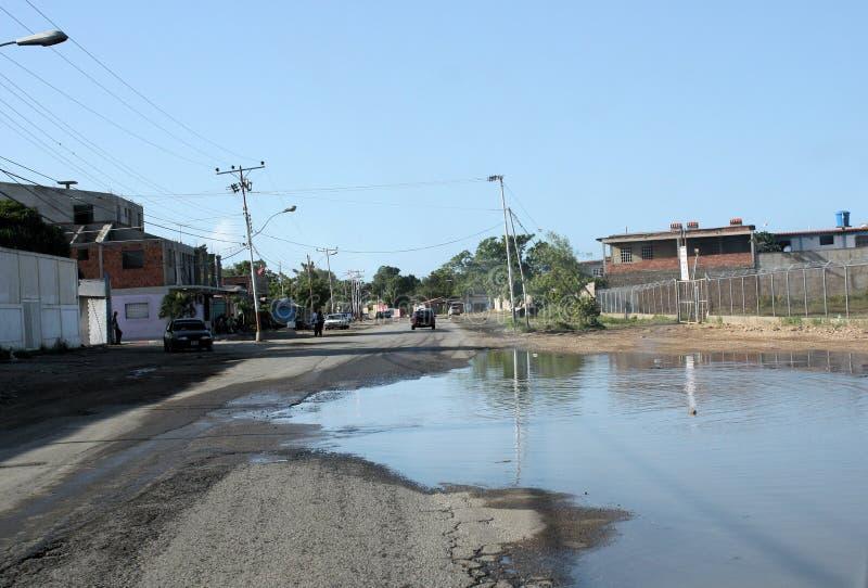 Rua completamente da água na cidade de Cumana imagem de stock royalty free