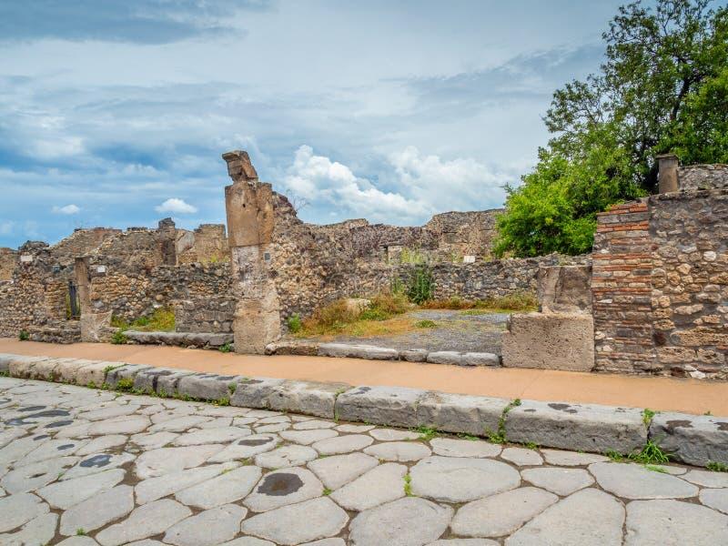 Ruas e casas de campo de Pompeii, Itália Lista do patrimônio mundial fotografia de stock