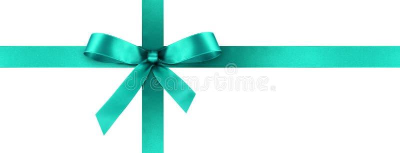 Ruban cyan de cadeau de satin avec l'arc décoratif - bannière de panorama photo libre de droits