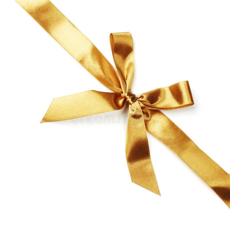 Ruban d'or d'arc de satin sur le blanc photographie stock libre de droits