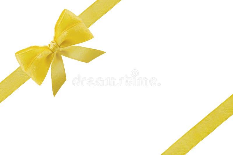 Ruban de cadeau pour la boîte de Noël Ruban d'or ou jaune d'arc avec des queues d'isolement sur le fond blanc image libre de droits