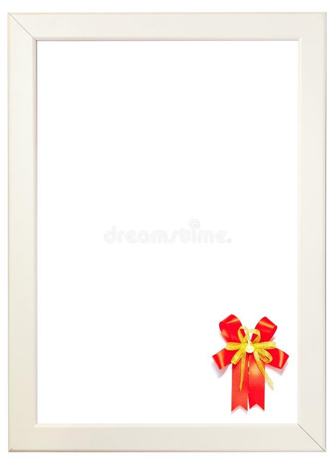 Ruban rouge décoré sur le bon coin du cadre blanc, gree de saison images libres de droits