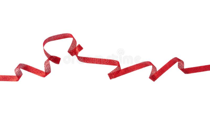 Ruban rouge de satin d'isolement sur le fond blanc, bannière photo libre de droits