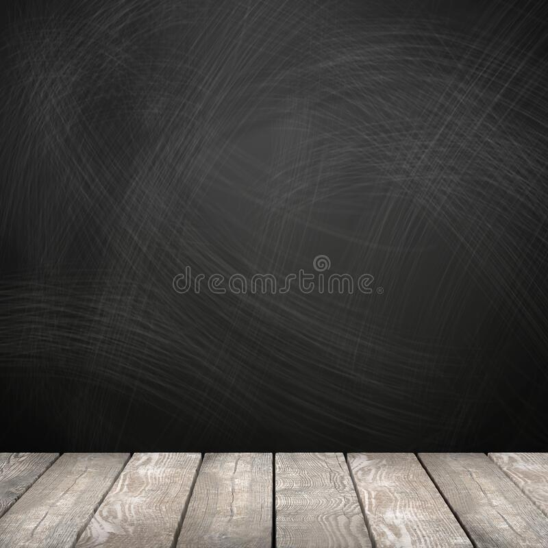 Rubbed out chalk on a blackboard, wooden floor royalty free stock photo