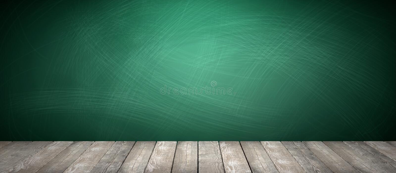 Rubbed out chalk on a greenboard, wooden floor royalty free stock images