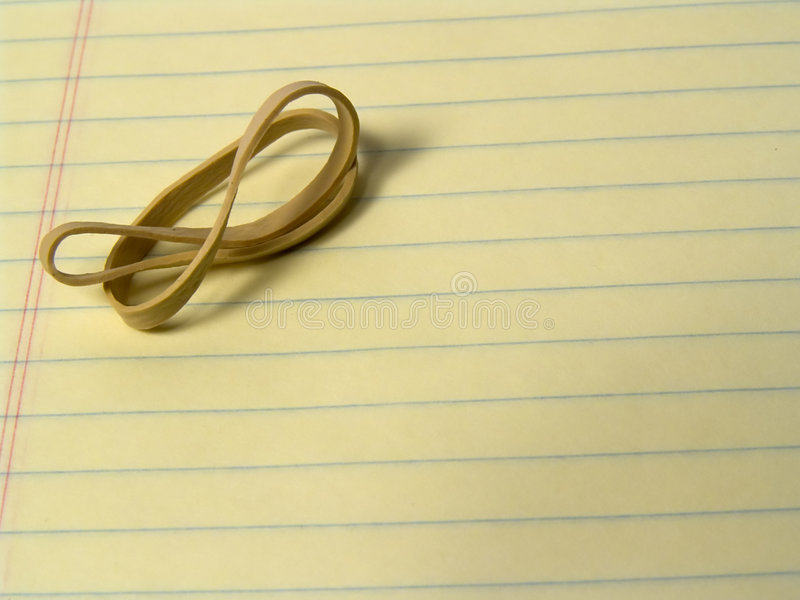 Download Rubber Band on Pad stock photo. Image of notepad, desk, metaphor - 12614