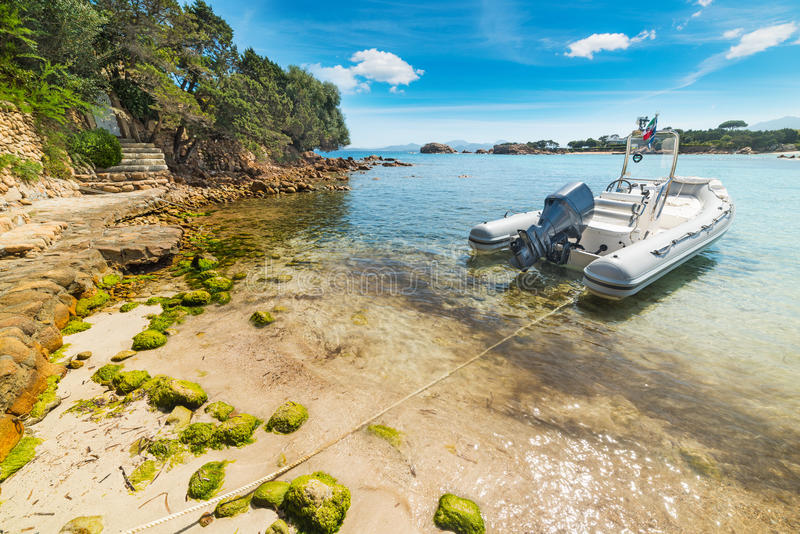 Rubber boat moored in a small cove. In Sardinia, Italy stock images