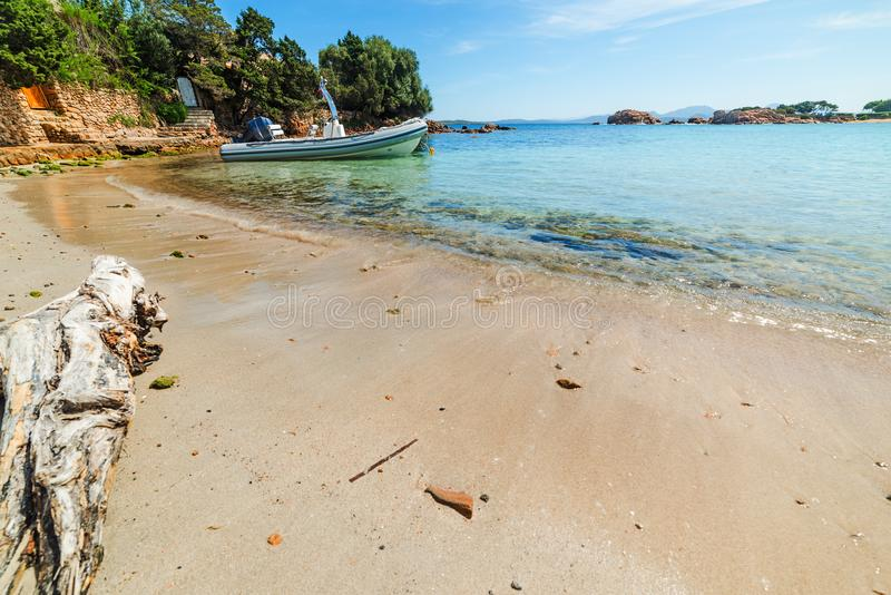 Rubber boat in a small cove in Sardinia. Italy stock images