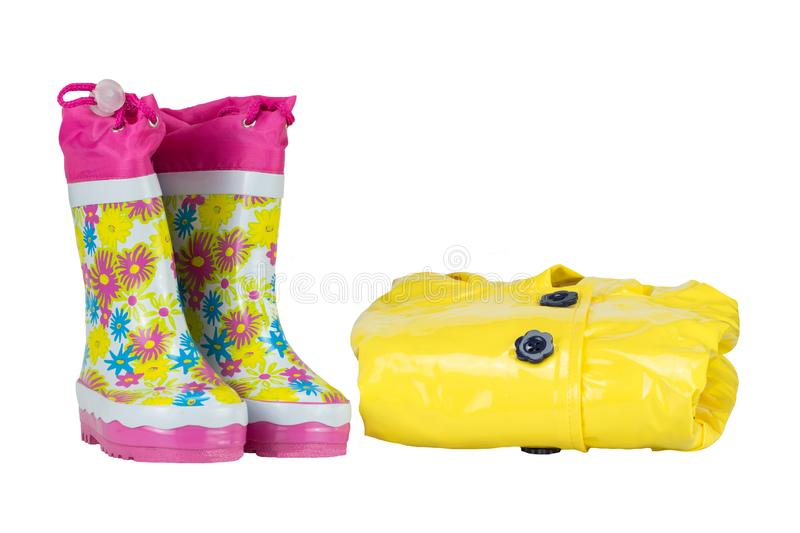 Rubber boots and elegance rain jacket yellow for girl. white isolated. stock photography