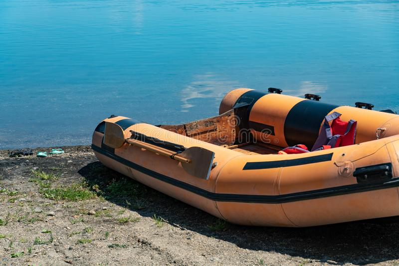 Rubber dinghy. Empty rubber dinghy on the beach royalty free stock photo