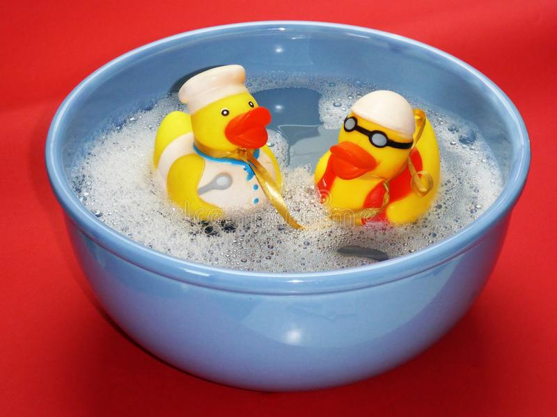 2 Rubber Ducky on Blue Ceramic Bowl royalty free stock image
