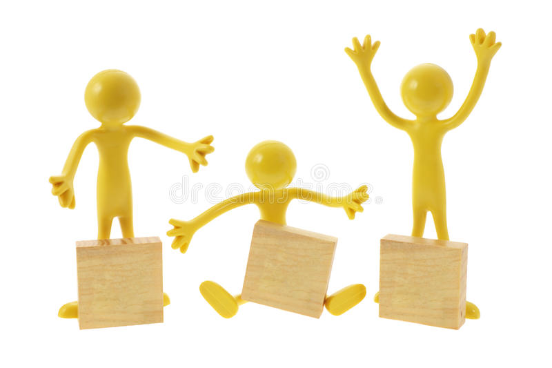 Rubber Figures with Wooden Blocks stock photography