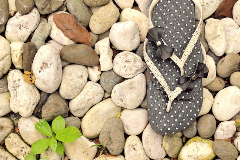 Rubber flip-flops. Black rubber white polka dots flip-flops - slippers royalty free stock photo
