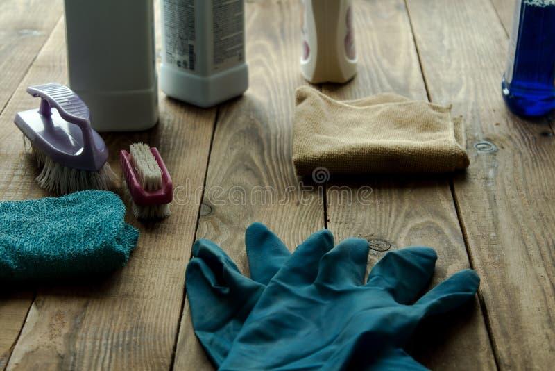 Rubber gloves brush duster stock photos