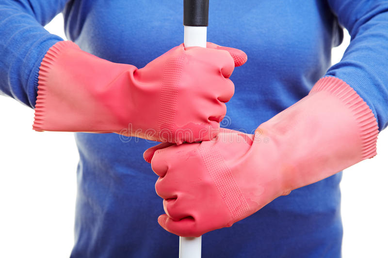 Download Rubber Gloves Holding Broom Royalty Free Stock Image - Image: 15963296