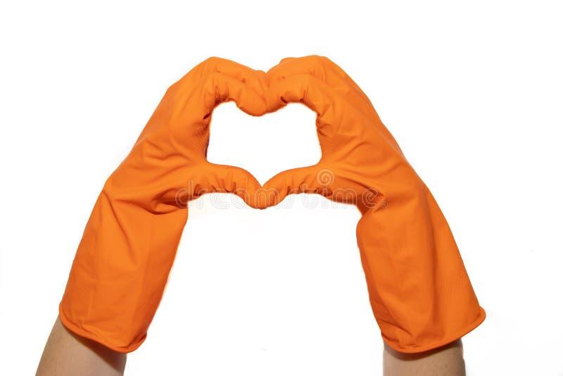 Rubber handskar för att göra ren gör en hjärta Förbereda sig för att göra ren Händer gör ren, når de har gjort ren Gnälligt folk  arkivbilder