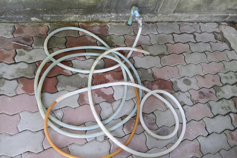 Rubber hoses and old faucets royalty free stock photo