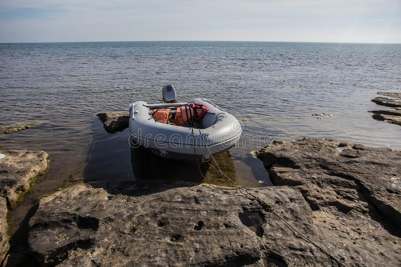 Rubber inflatable motor boat. Near the sea shore royalty free stock images