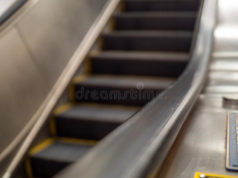 Rubber moving handrail on subway escalator going underground. Rubber moving handrail on subway escalator going under ground direction royalty free stock images