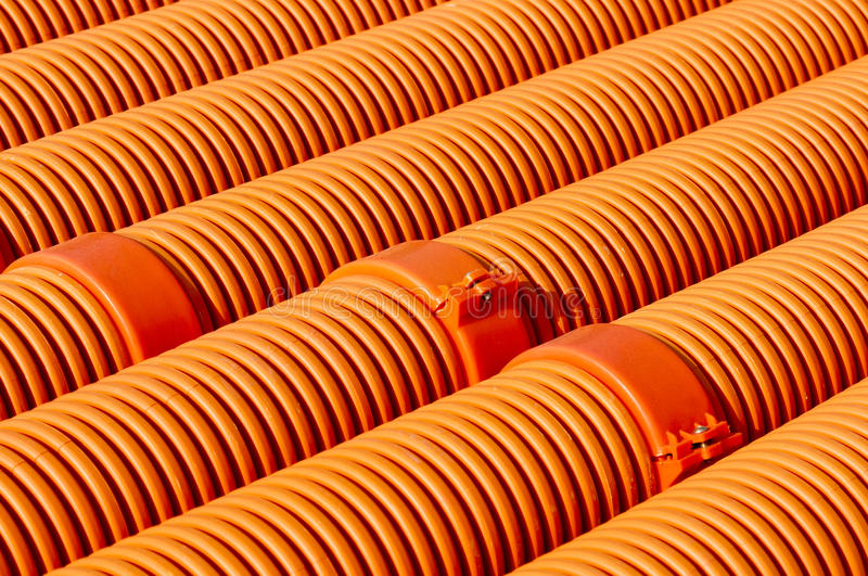 Rubber pipe. Many red Rubber pipe on the ground stock image