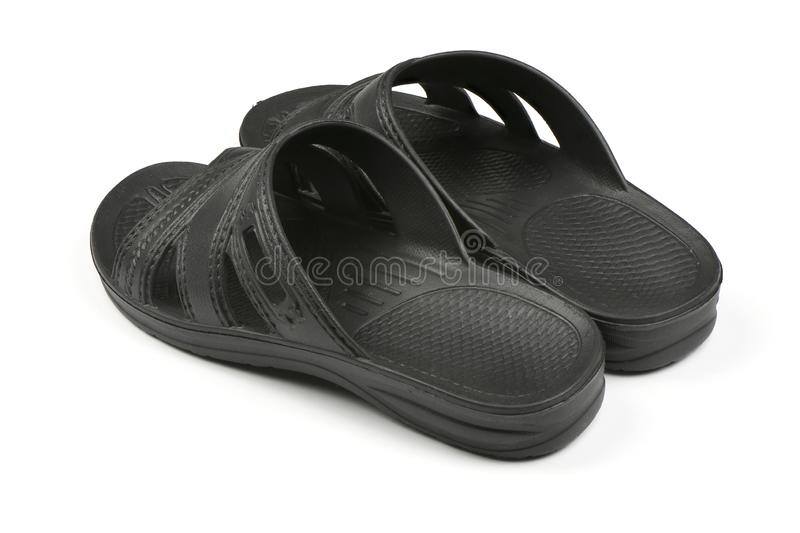 Rubber slippers. Pair of black flip flops isolated on a white. High resolution photo. Full depth of field stock photography