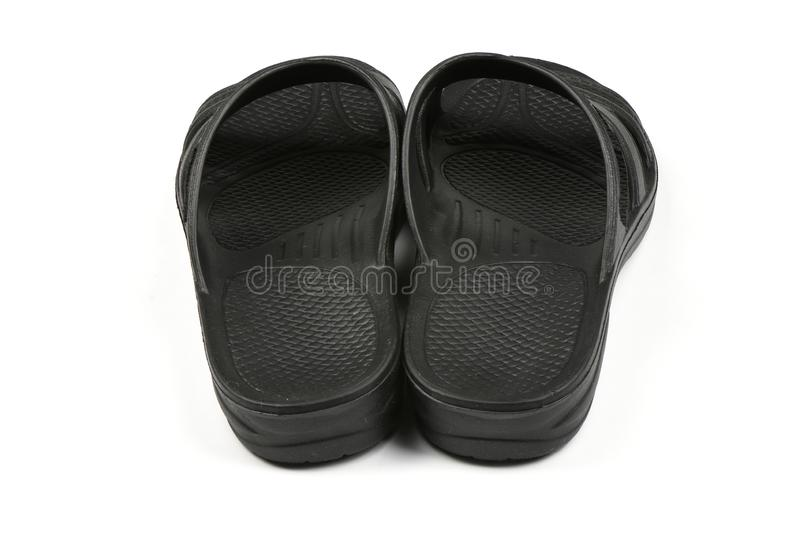 Rubber slippers. Pair of black flip flops isolated on a white. High resolution photo. Full depth of field royalty free stock photos