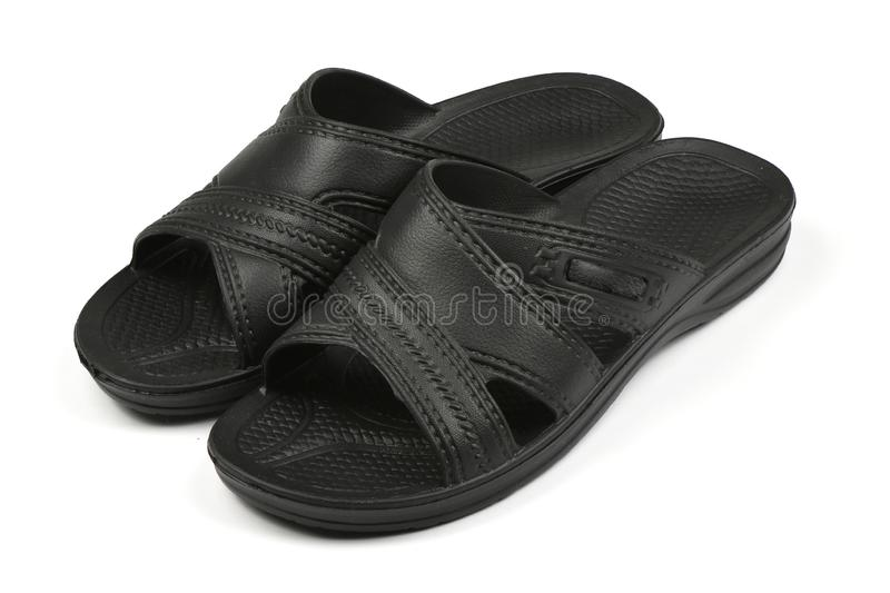Rubber slippers. Pair of black flip flops isolated on a white. High resolution photo. Full depth of field royalty free stock photo