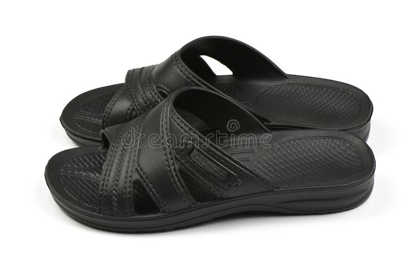Rubber slippers. Pair of black flip flops isolated on a white. High resolution photo. Full depth of field stock photo
