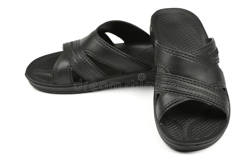 Rubber slippers. Pair of black flip flops isolated on a white. High resolution photo. Full depth of field royalty free stock photography