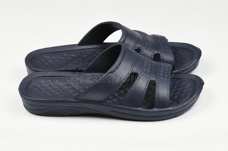 Rubber slippers. Pair of blue flip flops isolated on a white. High resolution photo. Full depth of field stock images
