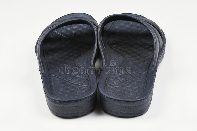 Rubber slippers. Pair of blue flip flops isolated on a white. High resolution photo. Full depth of field royalty free stock photography