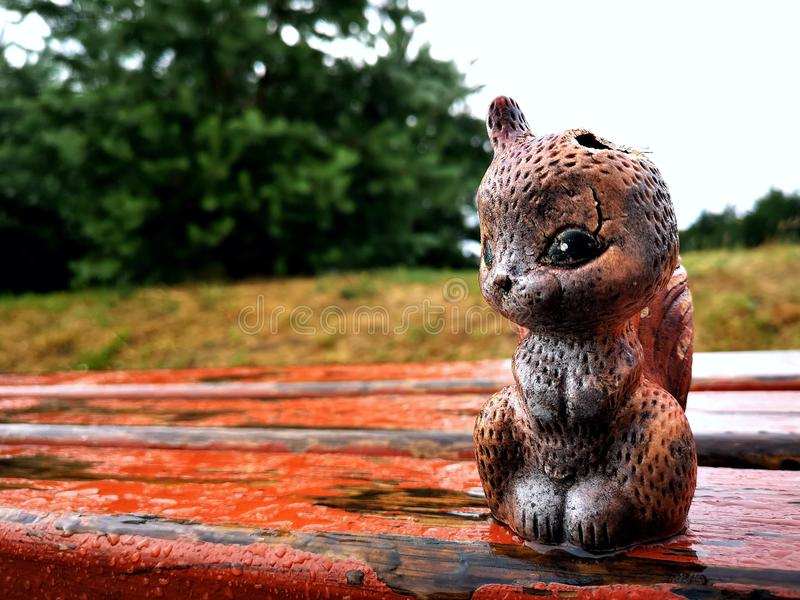 The rubber squirrel was left in the rain stock images