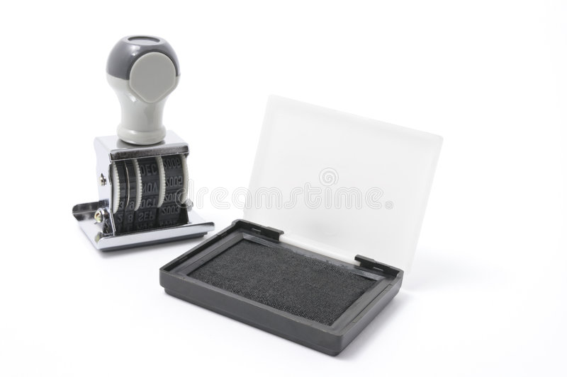 Rubber Stamp and Ink Pad. On White Background stock photography