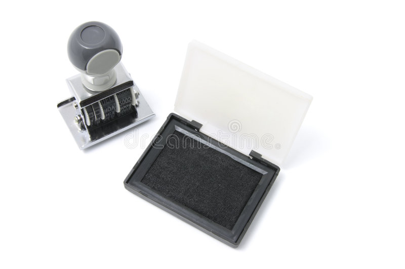 Rubber Stamp and Ink Pad. On White Background stock image