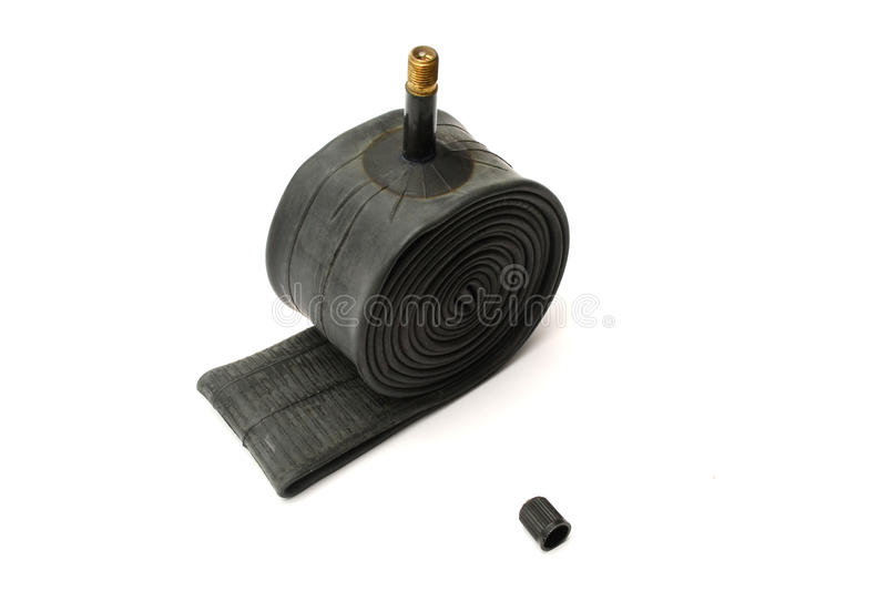 Rubber tire tube. Bicycle rubber tire tube roll up and cap stock photos