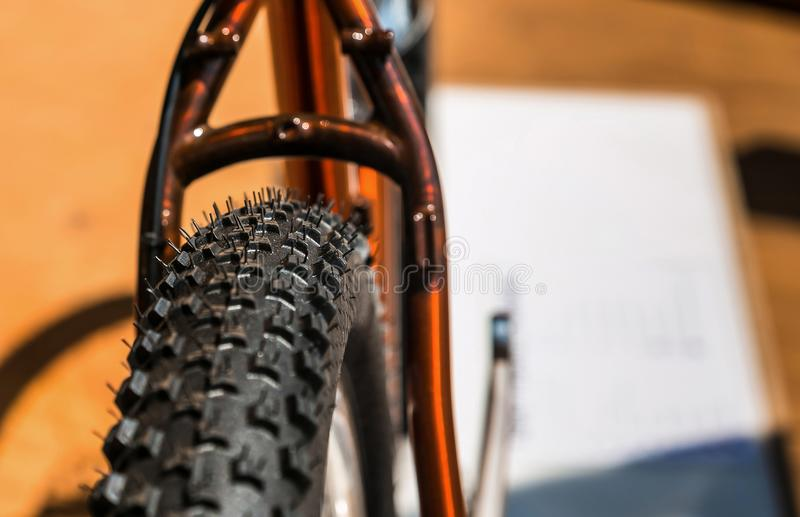 Rubber tire and wheel on a off-road mountain bike. Close up of a rubber tire and wheel on a off-road mountain bike royalty free stock photos