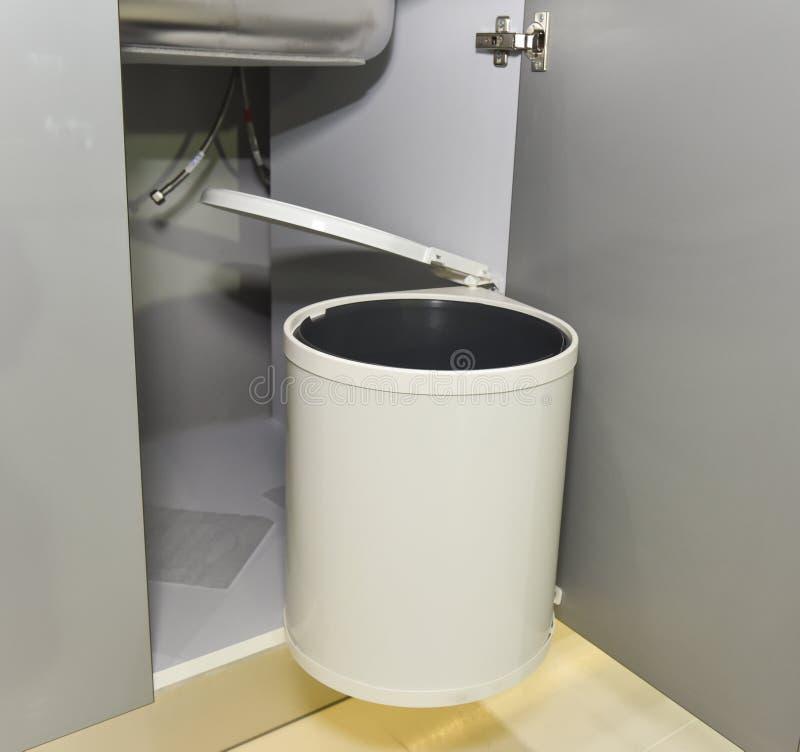 download rubbish bin hanging on kitchen cupboard door stock photo image