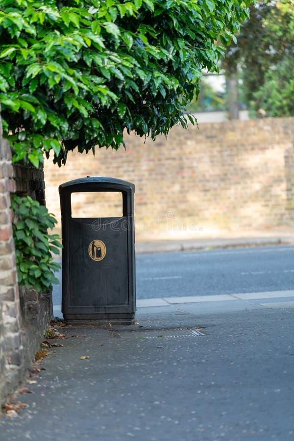 A rubbish bin on a path in Twickenham. West London, England stock photos