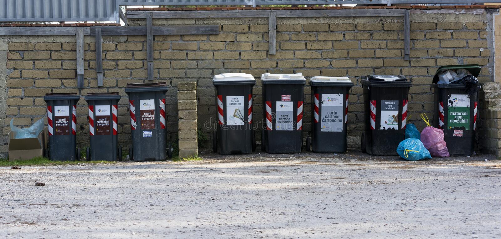 Rubbish bins of toxic waste. Row of rubbish bins of toxic waste along a road to Rome in Italy royalty free stock photo