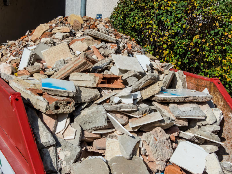 Rubble. From the demolition of a residential building in a container royalty free stock image