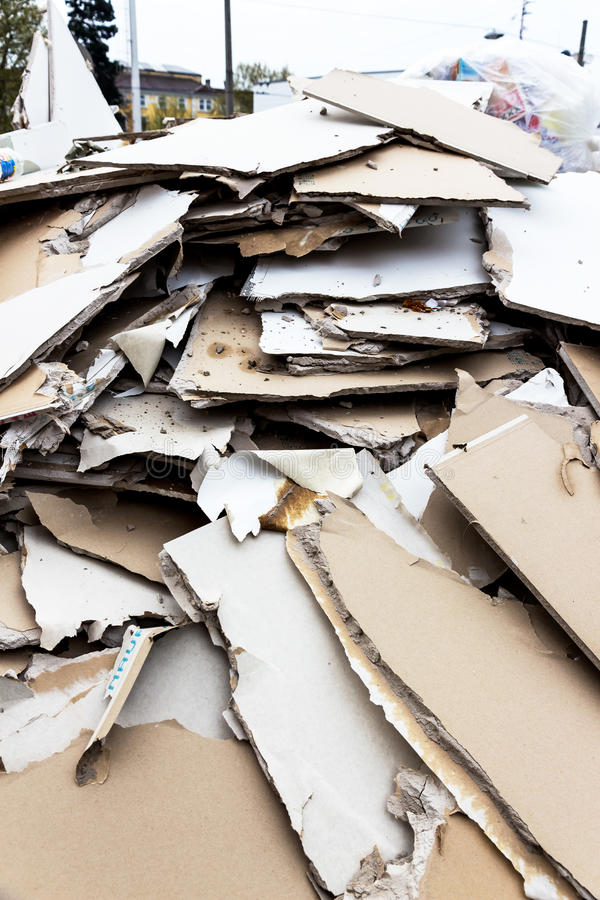 Rubble. plasterboard in the container. In a waste container store panels of plasterboard for their disposal royalty free stock photo